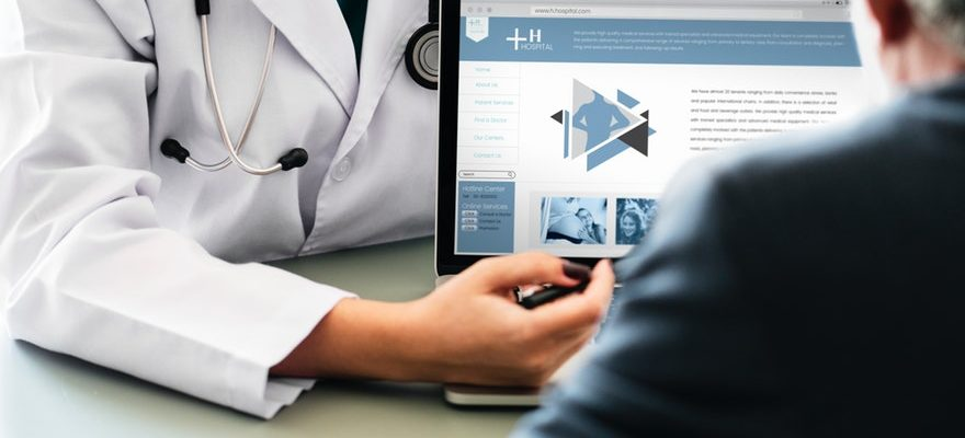Doctor pointing at Laptop