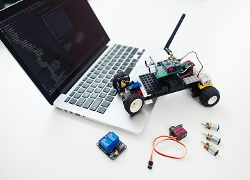 Diy rc car with components on laptop.