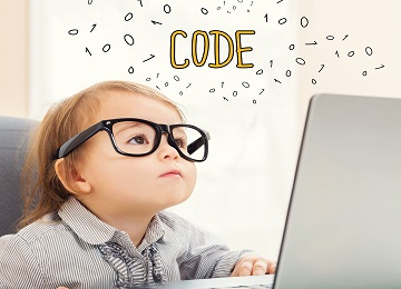 Code text with toddler girl using her laptop