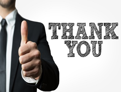 A man gives thumps up with the words thank you to the right