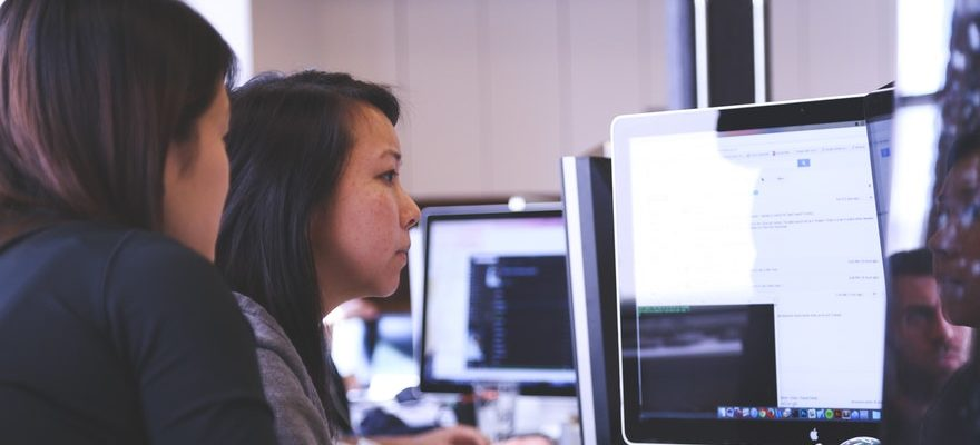 2 female coders in front of a computer
