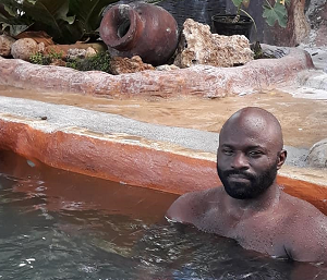 The Author, Jide Delano, in a natural hot-spring